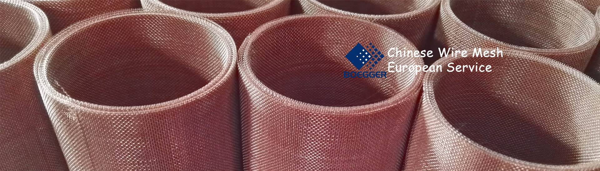 There are several rolls of coarse copper mesh gathering together, the structure is even and surface is bright.