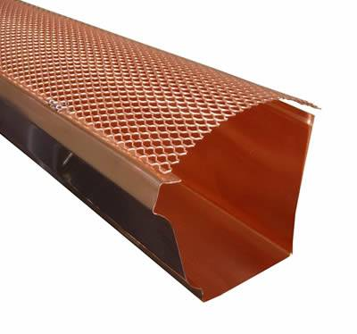 A piece of copper expanded mesh acting as the gutter guard.