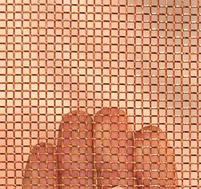 A piece of woven copper mesh on a woman's hand