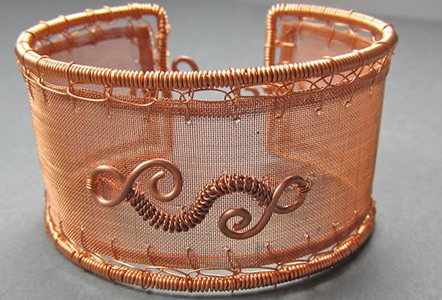 A unique woven cuff made of copper mesh and copper wire